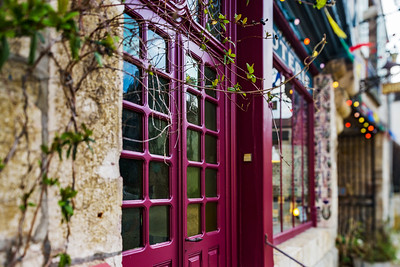 Old beautiful violet wooden door with glass in modern-style, Noyers