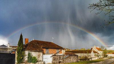 Full rainbow over the little city. Bourgogne, France.