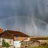 Full rainbow over the little city. Bourgogne, France.