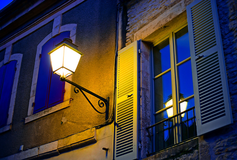 Evening time in old french city Vezelay. Light of old-styled street lantern.