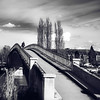 Pedestrian bridge across the river in Auxerre, black and white