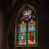 Colorful leaded pane in old medieval church, Noyers, France