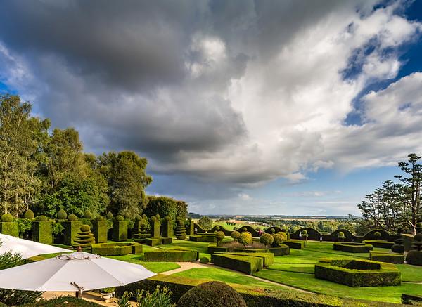 Regular garden in little french castle, sunset time
