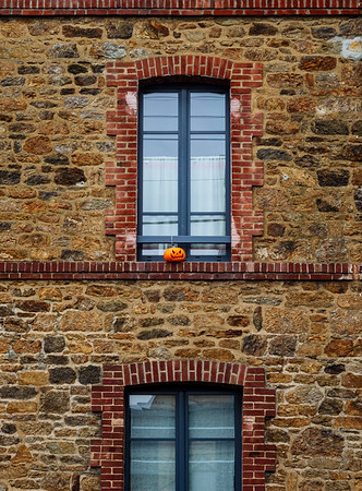 Cold stone architecture of the streets of Saint-Malo in Brittany, France, rainy seaside weather