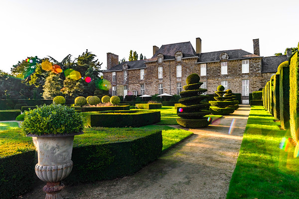 Regular garden in little french castle, sunset time