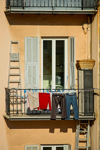 Laundry hanging out of a typical Nice facade