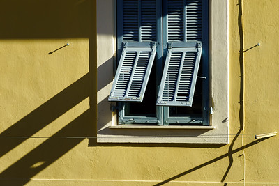 Shadows from the shutter on classic french or italian window