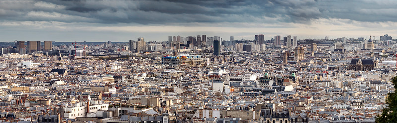 Panoramic view of the rooftops of Paris from Montmartre, sunset