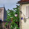 Typical french village street with retro-style lanterns