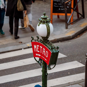 Signpost of the entrance to the metro in Paris. Classic lantern and inscription. Signs of Paris.