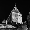 Carcassonne medieval fortress night view, old walls and towers highlighted
