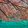Beautiful cyan-colored water of Lac de Bethmale, autumnal landscape, fresh and clear