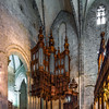 Carcassone medieval fortress panoramic view, sunset timeMajestic pipe organ with wooden decoration in the corner of Saint Marie church of Saint-Bertrand, France