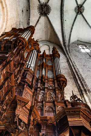 Majestic pipe organ with wooden decoration in the corner of Saint Marie church of Saint-Bertrand, France