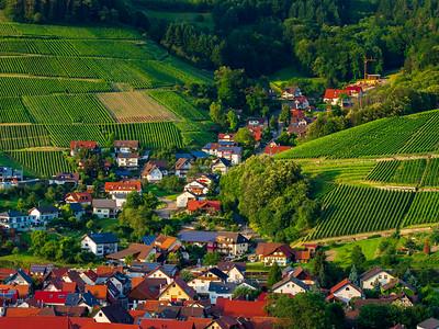 Little cozy german village between the green hills, vineyards in Black Forest
