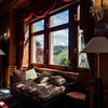 The luxury interior of the living room of the old castle. Sunlight falls from the windows
