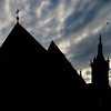 Black silhouette of medieval gothic church on sunset sky background