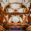 Gorgeous crystal round chandelier in an ornate old hall