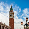St. Mark's Square in Venice. Tall bell tower on a sunny day.