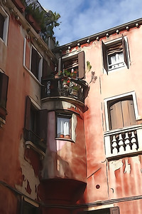 The streets of Venice. Beautiful multi-colored houses. The windows are closed with wooden shutters. Stunning lancet windows.