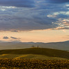 Colorful sunset in Tuscany, autumnal view of plowed hills. Italy.