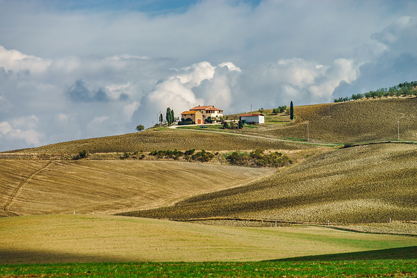 Villa in Italy, old farmhouse in the waves of tuscanian fields and hills