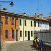 Sunlit streets of a small town in Italy. Colorful buildings, sunny shadows. Processing in the style of drawing.