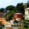 Bright and colorful Italian cityscape. Sunlit streets. Colorful houses. Warm and comfortable.