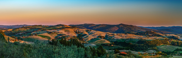 Colors of sunset. Panoramic hires view of Tuscany, hills near Volterra