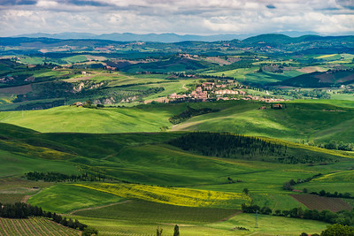 Classic Tuscany landscape. Green hills shimmering like waves.