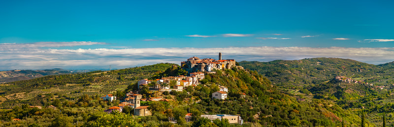 Beautiful medieval italian city on the green hill in Tuscany, panoramic view