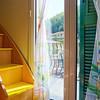 The morning sun breaks through the ajar curtains into the house.