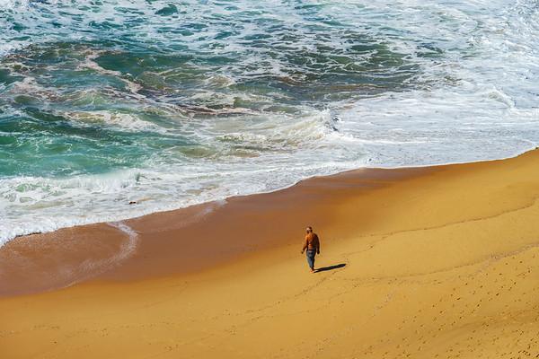 Vivid yellow sand and rocks on coastline, Portugal