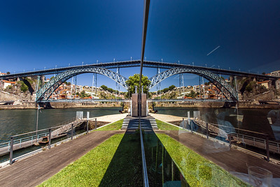 Mirror view of bridge over the river