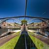 Mirror view of bridge over the river