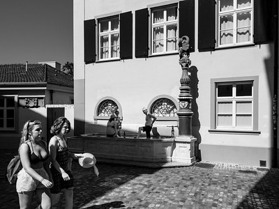 Editorial: 30th June 2019, Basel Switzerland. People bathe in the fountain in hot day in the downtown