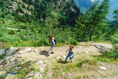 Family hiking in mountains, Alps, France, sunny day