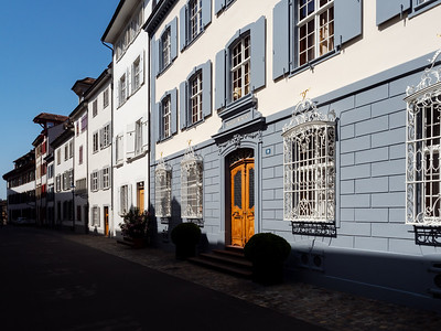 Calm narrow street, sunny summer day, cozy old downtown, Basel