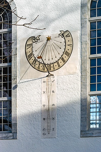 Old sun clock on the wall of church