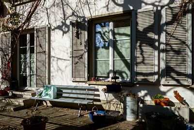Calm yard of little city house, beautiful shadows on the wall, Bern, Switzerland
