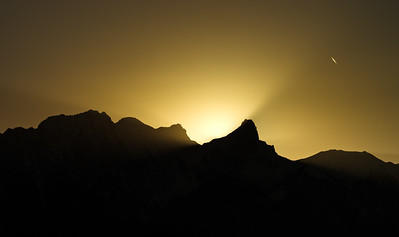 Beautiful yellow sunset over the mountains peak