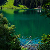 Lost in the mountains of Switzerland, Lake Arnesee with crystal clear waters of turquoise and azure colors.