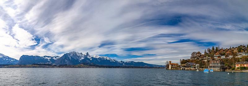 Panoramic view of Swiss Alps and Thun lake