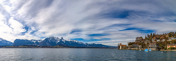 Panoramic view of Swiss Alps and Thun lake