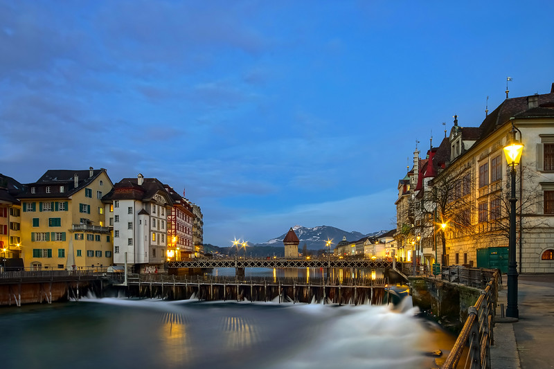 Luzern old historic center night view, highlighted buildings and reflections in the water