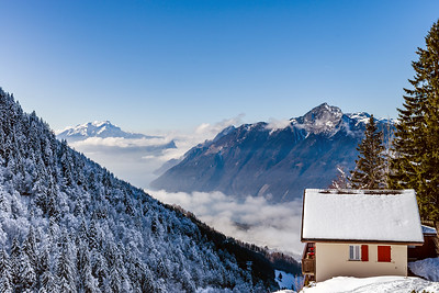 Natural landscape with lonely house in the snow. Alps.
