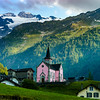Pink church in Trient on beautiful alpine background
