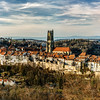 Old medieval city Fribourg on the hill, Switzerland, sunset time, panoramic view
