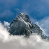 Clouds around the peak of beautiful rock