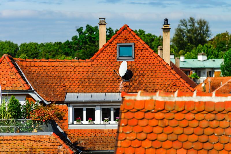Orange tile roofs of calm old quarter in Strasbourg